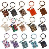 Wholesale diseñador bolso billetera leopardo estampado PU Pulsera de cuero Pulsera Llavero Tarjeta de crédito Bolsa de brazalete Bañolero Tassel Llavero Dama accesorios