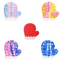 減圧玩具はそのPOPSの指でカラフルなクリスマスの手袋の形がカラフルされているカラフルなカラフルの形が贈られた子供の贈り物のためのポッパーの泡の指先感覚玩具