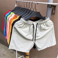 Erkek katı renkler plaj şort moda trendi şeker renkleri dsrawstring şort mayo yaz erkek yeni rahat spor iç çamaşırı kurulu şort