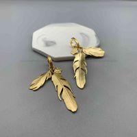 F family   fan Jiamei head maze diamond show Feather dumeisa big earrings exaggerated Earrings