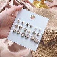 Lujosos diamantes artificiales Perlas Pendientes Pendientes Sol y estrellas Estilo Diseño Hermosas mujeres 9 pares Partamentos al por mayor por Set
