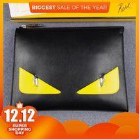 Covendi Monster Eyes Men's Bag Hand Bag Plain Leather Yellow Eyes Multi Card Leisure Bag Large Capacity Storage Bags