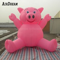 Custom giant inflatable holland pink pig sit on the ground animal balloon for advertising