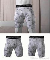 2020 Pantaloncini da running MATE all'ingrosso Indossare Fitness Collant Layer Running Men Shorts Fitness Allenamento Backing Summer Sports Uomo Abbigliamento fitness