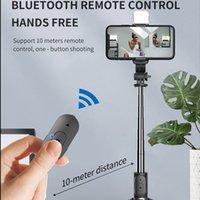 Q02S اللاسلكية selfie monopods ترايبود العالمي طوي مثلث قوس مع ضوء ملء للهواتف الذكية البث المباشر