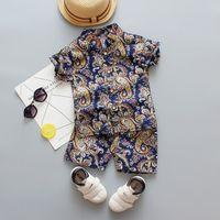 New Baby Summer Set 1 2 3 4 anni Moda Bambino Ragazzi Abbigliamento Beach Flower Stampa Camicia Vestita Abbigliamento Abbigliamento Costume T200707