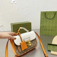 Tasarımcı Postman'ın zerdeçal çantası beyaz kemer kolu ile yaz aylarında taşınabilir! Boyutu: 21 14 * 5cm