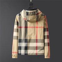 21Ss Men Дизайнерская куртка Роскошный светящийся двухсторонний материал Печатная одежда с капюшоном Длинные рукава Топы мужские и женские аутентичные теги