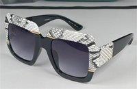 Yeni Moda Sıcak Kadınlar Tasarım Güneş Gözlüğü Kare Yılan Cilt Çerçevesi En Kaliteli Popüler Cömert Zarif Stil 0484 UV400 Koruma Gözlük