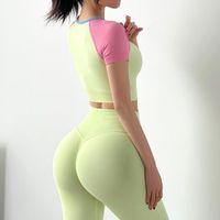 Equipo de yoga QRWR Womenwear ropa deportiva deportes de manga corta Macarrones Macarons Color Fitness Alto cintura leggings Gimnasio Conjunto de gimnasio Mujeres 2 pieza