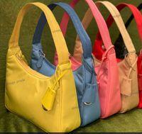 Высочайшее качество Роскошные дизайнерские мужчины женские повторные издание 2000 мешок с кроватими - нейлоновая мода кожаная девушка подарок на плечо сумка сумка сумки хобё винтажная сумка