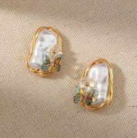 Boucles d'oreilles Vintage Vintage Ear Ear Ear Earcite Baroque Perle Papillon Creative Creative Mode Boucles d'oreilles Tempéramament Enroulement à la main Boucle d'oreille HWC6754