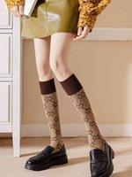Chaussettes hautes chaussettes printemps femme automne double g lettre m veaux marée marée marée net bas rouge coton pure coton polyvalent coréen moitié jambe