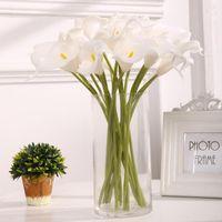 Guirnaldas de flores decorativas 10 unids de alta calidad Toque real Calla Lily Ramo artificial para la boda de la decoración de la flor del hogar de la boda