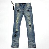 تصميم أزياء رجل جينز سليم الساق السراويل الأزرق ممزق نمط جيب ستار نمط الملابس للذكور عارضة نحيل السراويل الكلاسيكية