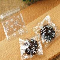 50 pz / lotto Arrivo 10x10cm Clear Christmas Snowflake Cookie Bag, Guarnizione autoadesiva in plastica cellophane, panetteria regalo cello borse involucro