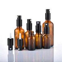 Wholesale Amber Стекло Эфирное масло Парфюмерные Бутылки с качественными бутылками с качественным черным точным туманом распылителя / лосьон насос сверху, 5 мл-100 мл
