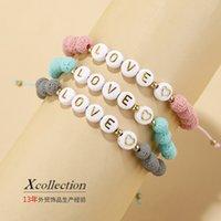 Joyería hecha a mano al por mayor 2021 pulsera femenino de color de piedra de piedra decoración de la mano y2k accesorios amantes letra arroz bead suave cerámica pulsera