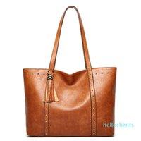 Cross-border women's bag 2021 new European and American fashion retro large capacity hand shoulder bag rivet simple Tott bag