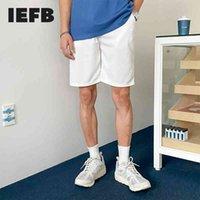 IEFB Summer Shorts Men's Korean Fashion White Knee Length Pants Casual Loose Drasstring Elastic Black Beach Sports Shorts 9Y7206 210524