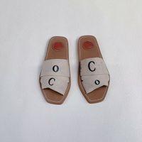 Top Femmes Woody Toile Chaussons plats Sandales Sandales Flip Flop Chaussures d'été Femme Sliper Designer Beach Shos Lady Chambre Shoe