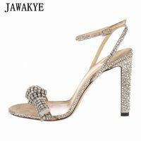Jawakye Chrinestone Женщины Сандалии на высоком каблуке Блестящие открытые пальцы на лодыжке Party Свадебные туфли на взлетно-посадочной полосы дизайн знаменитости летние сандалии U3QD #