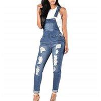 Женская дыра тощий слинг джинсы моды Trend кнопка карманные женщины динамические брюки дизайнер осень женские повседневные тонкие карандашные брюки