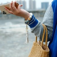Keychains 2021 Creative Summer Silicone Bead Wrist Keychain Europe And America Wooden Tassel Anti-lost Key Ring Pendant