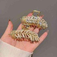 FACTORY OUTLET Capelli Clips Barrettes Metallo Hair Clip perla Rhinestone Foglia di Foglia di Acero Girl Girl Rete Coreano Red Purchin Catch