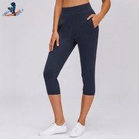 Yoga roupa de profundidade mulheres Capri calças com bolsos atlético fitness estiramento esportivo anti-suor rápido seco nylon bezerro de nylon