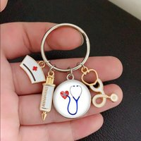 الأزياء الإبداعية ممرضة محقنة الطبية سماعة السماعة صورة المفاتيح الزجاج كابوشون كيرينغ حامل قبة مفتاح خواتم قلادة هدية