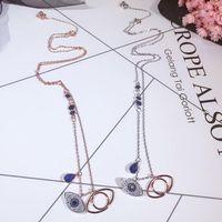 Berühmte design doppel blau böse augen kurze halskette für frauen gold farbe kubikzirconia charme feminino bijuterias anhänger halsketten