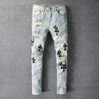 Mens Jeans Giyim Denim Pantolon SLP Mavi / Siyah Yıkılan Erkek Ince Düz Biker Skinny Jeans Erkekler Jean Madalya Dekorasyon Yırtık