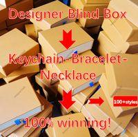 100+ مصمم المفاتيح الرجال عشاق المرأة carkeychain bagkeychain الأزياء مفتاح سلسلة زهرة شعرية قلادة مع مربع سوار قلادة