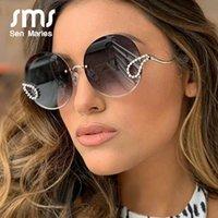 2021 Nuovi metalli Diamond Sunglass Donne Brand di lusso attorno al telaio casuale Glass da sole in vetro per donna UV400 Glass