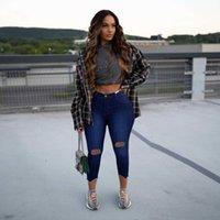 Leggings dei fori della moda delle donne sottili dei jeans