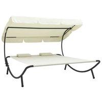 Lit de salon extérieur avec canopée et oreillers crème blanc