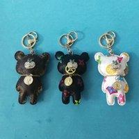 럭셔리 패션 가죽 다이아몬드 곰 키 체인 파티 호의 펜던트 크리 에이 티브 자동차 귀여운 열쇠 반지 가방 매력 선물