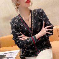 Женские вязаные тройники вязаные кардиган контрастность цвет полоса полоса корона v шеи кнопка с длинными рукавами тонкий свитер оптом женская одежда