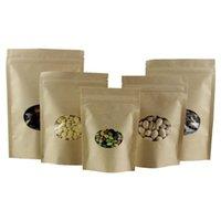 Bolsas de almacenamiento 50 unids / lote Papel kraft de pie bolsa con ventana elíptica Doypack Caramelo Snack Bean Bean Packaging Bolsas