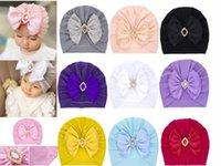 10 ألوان طفلة بيني الربيع الخريف القبعات الوليد مع القوس حجر الراين تصميم بلون الرضع أطفال قبعة قبعة