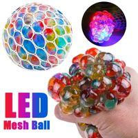 1 UNID Divertido antiestrés Squishy LED Malla LED Bola de uva Sensor Sensor Fruitaria Novedad Juguetes Niños Adultos Play Vent Fidget Toys Regalos CS06