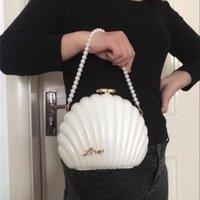Christmas gift handbag Camellia Elegant women's fashion Backpack Gorgeous acrylic shell shoulder bag pearl chain party bag VIP gift bag