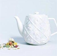 En Çok Satan 14 CM K A W S Seramik Çaydanlık Originalfakte Tatil Taipei İçbükey ve Dışbükey Logo Su Isıtıcısı Companion Galeri Orijinal Sahte Masaüstü