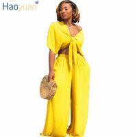 Haoyuan Сексуальные два куска набор женская одежда V-образным вырезом галстука толстовки + свободные ширины брюки ног костюм летний наряд 2 шт повседневной трексуита B61G #