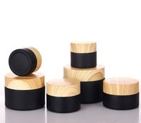 Cream bottle 5g 10G 15G 20G 30G 50G small black glass jar matte with plastic lid cap bamboo wood strain round waxco smetic container 5ml custom