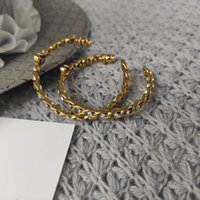 fashion restoring ancient ways matel hoop earring accessories with rhinestone c symbol wth paper card