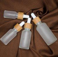 30ML متجمد زجاجة قطارة واضحة مع غطاء الخيزران الغطاء الزجاجي الزجاج الضروري الصقيع الأخضر العطور قوارير EWA5164