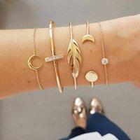 Boucles d'oreilles de concepteur bagues de fiançailles, bracelets et colliers en or sont les favoris Femmes Bracelets de charme Moon Feuilles rondes Diamant Cross Cross Cince Séta3vm6etn