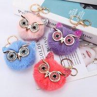 Regalos de fiesta Lentejuelas de polvo de oro Ojos grandes Owl Ball Peluquería Colgante Llavero Imitación Conejo Cat Fur Ladies Bag Llavero HWA7578